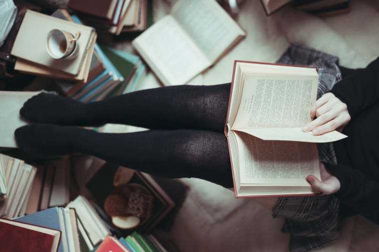 Girl with lots of books